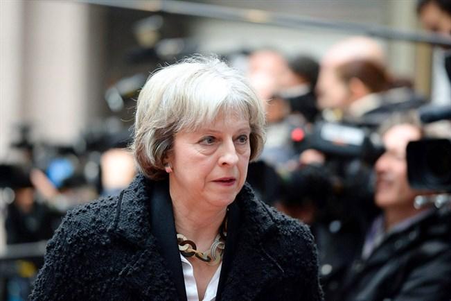 """Theresa May perusteli vaatimustaan sillä, että sopimus """"sitoo parlamentin kädet"""" ja tekee maasta turvattomamman, koska se estää vaarallisten ulkomaalaisten karkottamisen. Lehtikuva/ Thierry Charlier"""